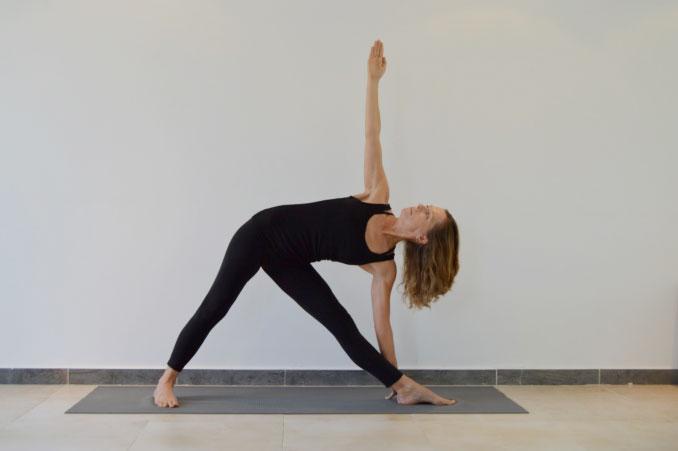 Justine Rowan Yoga Teacher Demonstrating a Yoga Pose